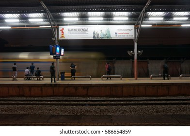 April 19th, 2014 - Selangor,Malaysia. Blurred movement of commuter and passengers at the train station in Malaysia. Blurry effects due to camera technical setting.