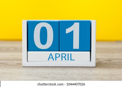 April 1st. Day 1 of april month, calendar on yellow background. Spring time, Easter and fools day