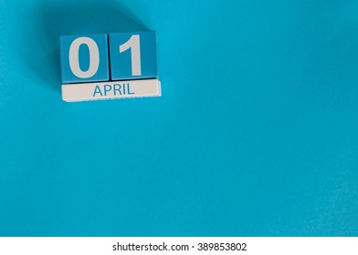 April 1st. Image of april 1 wooden color calendar on blue background.  Spring day, empty space for text. All Fool's Day