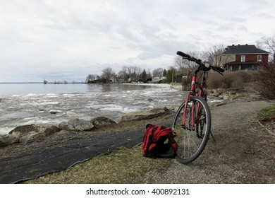 April 2, 2016 - Pointe-Claire, Quebec, Canada.  Bicycle parked beside ice-thawing Lake St-Louis.