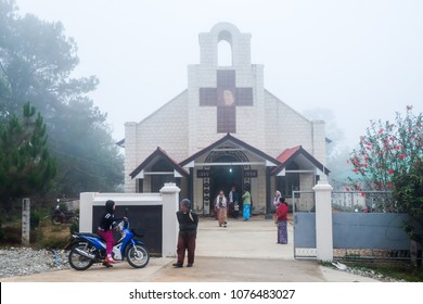April 2 2017 - Loimwe, Shan State, Myanmar. Churchgoers leaving church erected in 1933