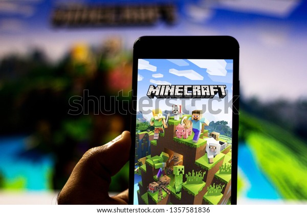 April 2, 2019, Brazil. Minecraft logo on Android mobile device. Minecraft is an open-world, independent, sandbox-style electronic game that allows you to build blocks from which the world is made.