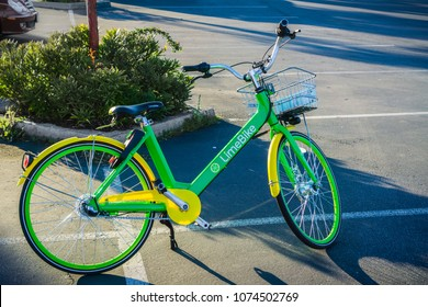 April 20, 2018 San Mateo / CA / USA - LimeBike left on a parking lot in San Francisco bay area