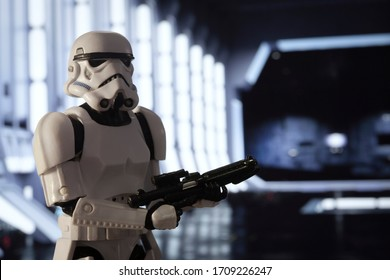 APRIL 20 2020: Imperial Stormtrooper stands guard inside the docking bay of a star destroyer - Hasbro action figure