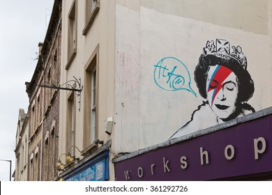 April 2014 - Bristol, United Kingdom: A graffiti of the Royal Queen with red and blue  lightning shaped make-up to the right closed eye
