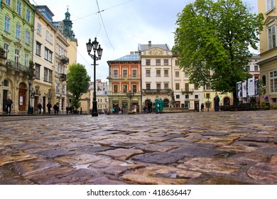 April 2016 - Market Square - central historical square in Lviv, Ukraine on a rainy day - UNESCO world heritage site