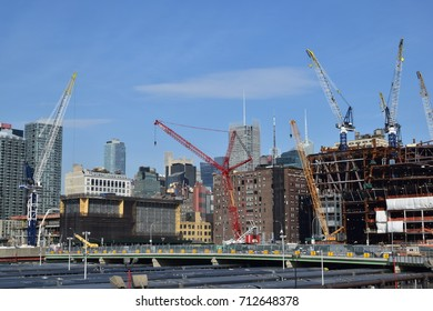 APRIL 2016 - NEW YORK CITY: CraneS and building construction site against blue sky in New York City, NY in April 2016