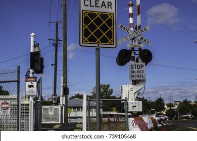 April 2017, Gatton, Australia, rail crossing in a small town with lots of warning signs and red and white colors