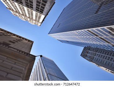 April 2017 - NEW YORK CITY: Perspective photograph of tall buildings /skyscrapers in the financial district looking up frfom ground level in NYC in April 2017