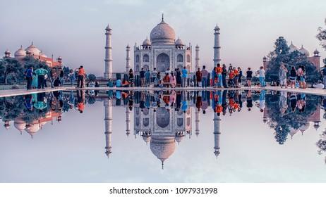 April 2018 - Agra, India - Tourists contemplating the  Taj Mahal in sunrise light, Agra