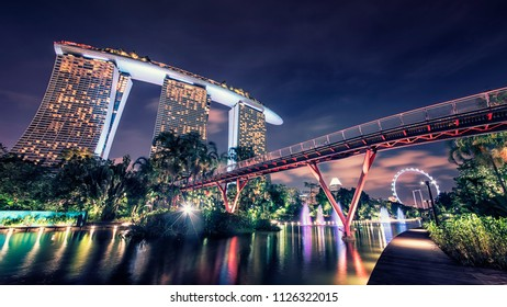 April 2018 - Singapore - Garden by the Bay and Marina Bay Sands hotel in Singapore at evening
