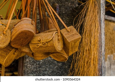 April 2018. Traditional wickerwork made from straw. Bags, plates, cups. Made in traditional village on the East of Bali island.Indonesia.