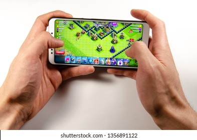 April, 2019. Kramatorsk, Ukraine. Clash of Clans gameplay on a white smartphone in hand