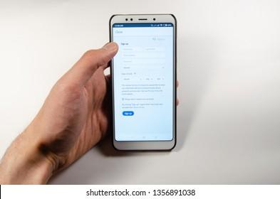 April, 2019. Kramatorsk, Ukraine. Mobile application Lightroom mobile on a white smartphone in hand