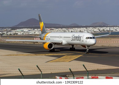 April 2019. César Manrique-Lanzarote Airport. Thomas Cook, Condor, Boeing 757-300 in the taxi way for taking off. Condor forms together with Thomas Cook Airlines UK and Thomas Cook Airlines Scandinavi