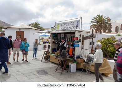 April 2019. Teguise or La Villa town on Lanzarote island.  Lanzarote's Sunday street market. Weekly flea market. Event. Canary Island. Stall with local made Vinos de Lanzarote (local wine).