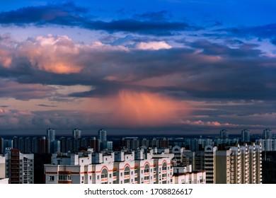 April 2020. Dark clouds in Drozhzhino village. Toned photo. Moscow area. Russia.