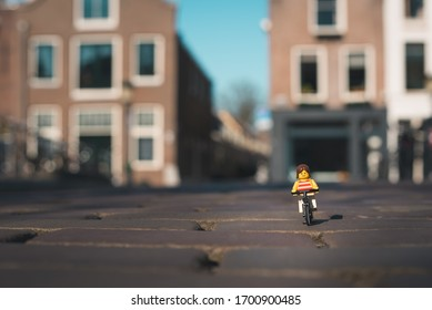 April 2020 lego girl on her bike in Utrecht in the Netherlands