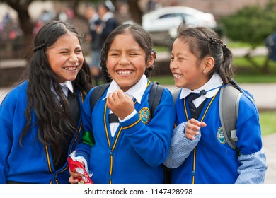 April 21, 2014 - Cusco, Peru. Group of smiling children heading to school in the morning. Walking down the street in school uniforms.