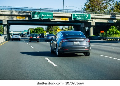 April 21, 2018 Mountain View / CA / USA - The new Model 3 Tesla driving on the freeway in Silicon Valley, south San Francisco bay area