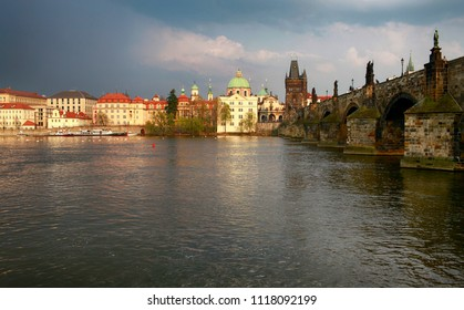 April 22, 2013, the Czech Republic, Prague. Nice view when the sun lit up the city after the rain. Charles Bridge and the waters of the Vltava River