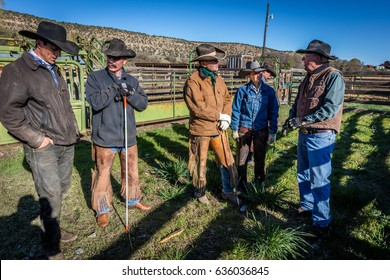 APRIL 22, 2017, RIDGWAY COLORADO: ranch owner Vince Kotny speaks to Cowboys who are branding cattle on Centennial Ranch, Ridgway, Colorado