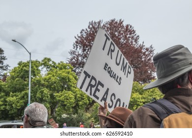 April 22, 2017 SANTA ROSA, CA USA -Protester carries sign that say Trump is Treason during Earth Day's March for Science.