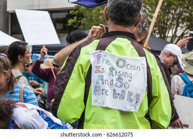 April 22, 2017- SANTA ROSA, CA., USA - Protestor has sign on his about the ocean's rising during the Earth Day March for Science.