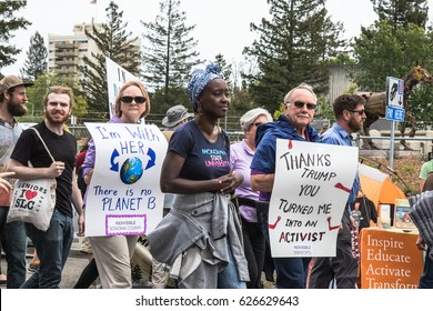 April 22, 2017- SANTA ROSA, CA., USA - Protesters march and hold signs during the Earth Day March for Science.