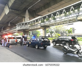April 22, 2018. Bangkok Thailand, The Accident on road with car and motercycle is crash. Ambulance is coming to see patient.