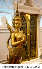April 2,2019: in Don Muang Airport ฺ  Bangkok Thailand: Golden Kinnari statue at Don muang Airport  Half-bird, half-woman