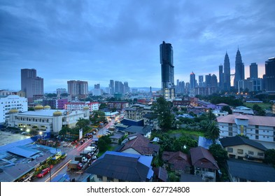 April 22nd, 2017 - Kuala Lumpur, Malaysia. Morning cloudy sunrise view in Kuala Lumpur with the close outlook of wooden village houses in the city.