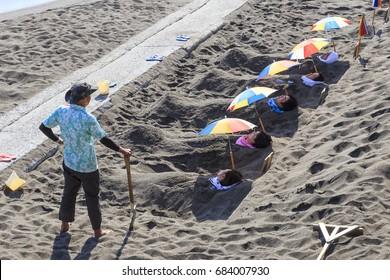 April 23 2017. People taking a bath of hot sand in Kagoshima beach. April 23 2017 Kagoshima Japan.