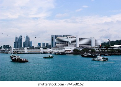 April 23rd, 2017, Sentosa Island, Singapore. This picture was taken from Sentosa Gateway to show Vivo City. Cargo ships and cruises were run through this river to the harbor.