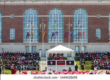 April 24 2015 Middletown USA - Lin-Manuel Miranda giving commencement address at Wesleyan University in outdoor ceremony with flags waving and surrounded by faculty