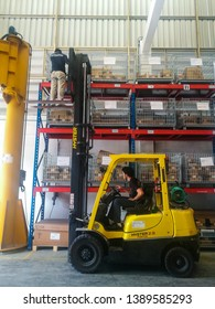 April 24,  2019. Worker standing on the  forklift with unsafe position at warehouse , Rayong , Thailand