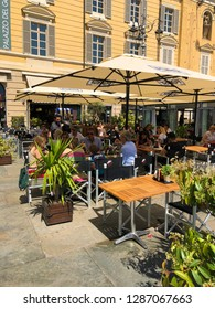 April 25 2018 Parma, Italy: outdoor restaurant full of visitors on a sunny day
