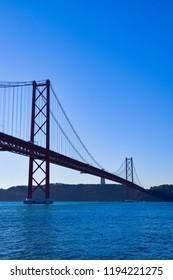 The April 25 Bridge across the Tejo river, Belém, Lisbon, Portugal.