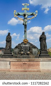 April 26, 2013, the Czech Republic, Prague. Cross crucifix statue on the Charles Bridge