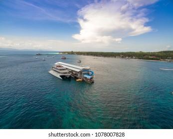 April 26 2018 Bali Indonesia : Quicksilver boats taking tourists on Lembongan to Nusa Penida, snorkeling diving, banana boat, water sport, parasailing, jet sky, fly fish, trips full day cruis Bali