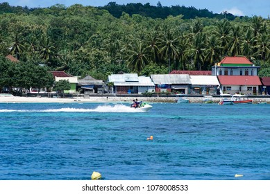 April 26 2018 Bali Indonesia, Quicksilver Silversonic boats taking tourists on Lembongan to Nusa Penida, snorkeling diving, banana boat, water sport, parasailing, jet sky, fly fish, trips full day cru