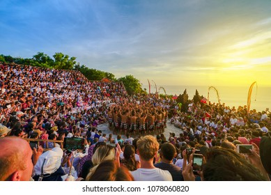 April 26 2018 Bali Indonesia, Tourists watch traditional Balinese Kecak Dance at Uluwatu Temple on Bali, Indonesia. Kecak (also known as Ramayana Monkey Chant) is very popular cultural show on Bali.