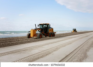 April 26, 2018. Gulf of Mexico, Padre Island, Texas. Grader adjusting send level on the beach. Beach Maintenance.