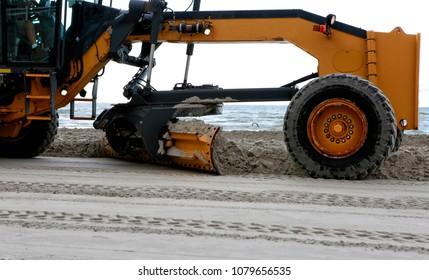 April 26, 2018. Gulf of Mexico, Padre Island, Texas. Grader adjusting send level on the beach. Beach Maintenance.