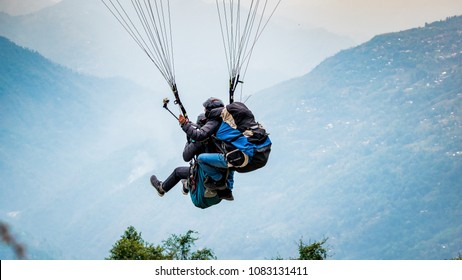 April 26,2018. Delo,Darjeeling, India. Paraglider with tourist  is starting to start his flight.