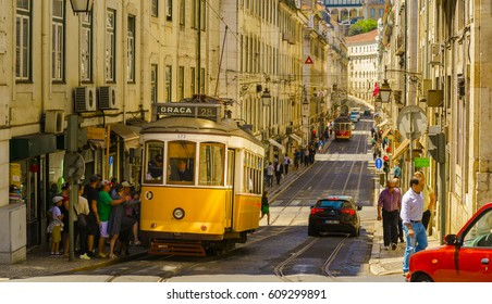 April 26th, 2014 : Lisbon - Portugal : Typical yellow tram in one of the main streets of Lisbon