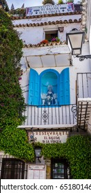 "April 27, 2017, Marbella Spain.  ""Virgin Mary Balcony Restaurant"" (restaurante balcon del virgen) in Marbella, with a life-size Madonna statue inside a window on its balcony."