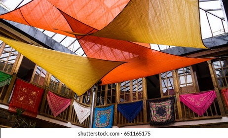 April 27, 2017 Old Town, Ronda Spain.  Scarfs and Sails.  Whimsical roof decoration of a winery in Ronda Spain.