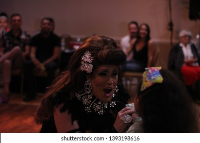 April 27th 2019. York. P.A. Drag Queen Katrina Enscalarza thanking a supportive child at Lequitcha's Dinner Show.