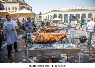 April 28, 2019. Athens, Greece. Kokorec and lamb are grilling on skewers over charcoal fire. Greek Easter custom, Monastiraki